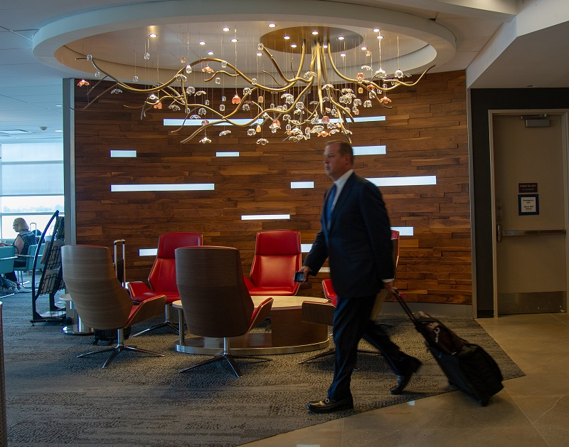 Customer walks by an elaborate chandlier in the reopened D.C. Sky Club